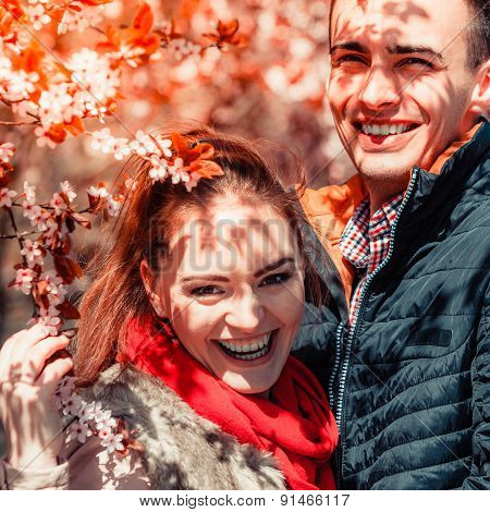 Couple In Love Walking In Park At Sunny Spring Day