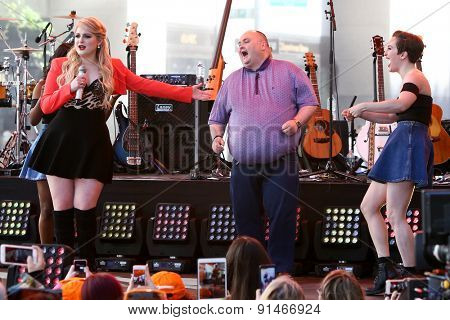 NEW YORK - MAY 22: Singer Meghan Trainor (L) dances with Sean