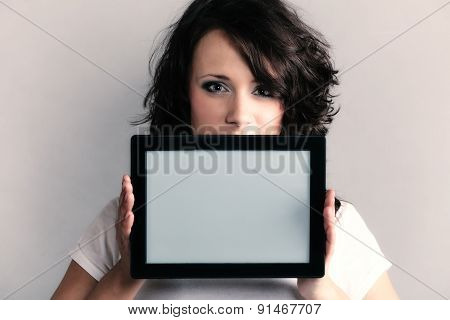 Sexy Girl Showing Copy Space On Tablet Touchpad