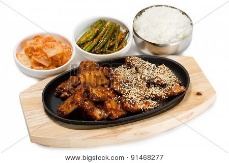 Fried pork ribs with sesame seeds, rice, kimchi and bamboo shoots. From a series of Food Korean cuisine.