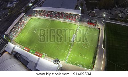 MOSCOW, RUSSIA - APR 28, 2014: Aerial view of people play soccer on field with illumination near Locomotive Small Sports.