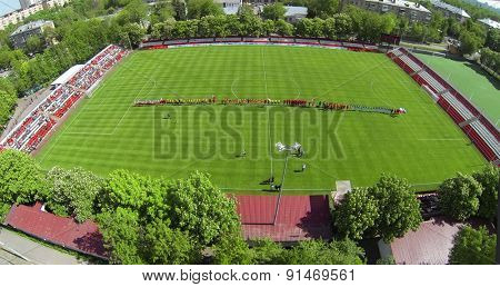 RUSSIA, BOGORODSKOE - MAY 14, 2014: Teams play soccer on field of Spartakovec stadium named by N.P. Starostin during international competition. Aerial view