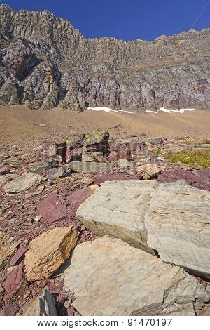 Colorful Rocks Below A Mountain Ridge
