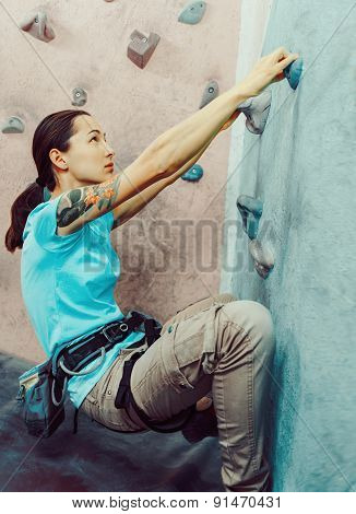 Young Woman Starting Climbing