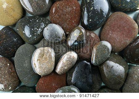 Wet sea pebbles background