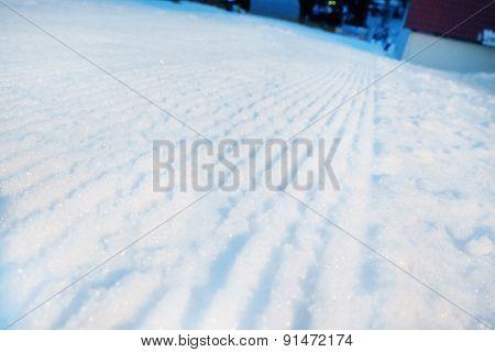 Shiny snow with tracks, outdoors