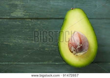 Sliced avocado on wooden background