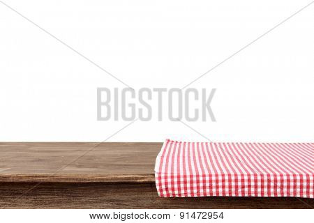 Empty wooden table with napkin and white background