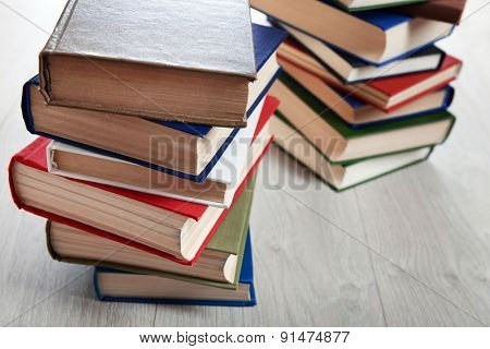 Stacks of books on wooden background