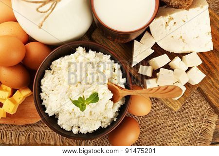 Tasty dairy products on sackcloth background