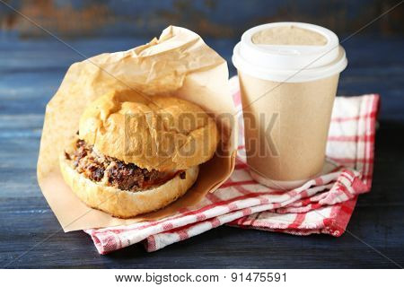Tasty burgers on wooden table background, close-up. Unhealthy food concept
