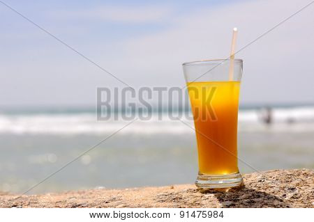 Cold fresh cocktail on the beach
