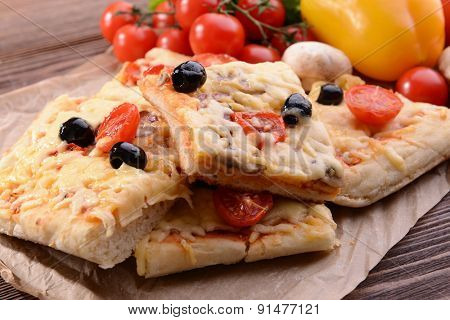 Delicious homemade pizza on table close-up