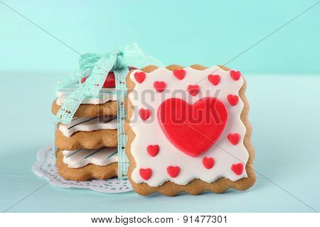 Heart shaped cookies for valentines day on color wooden background