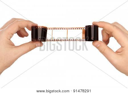 Photographic film in hands isolated on white background