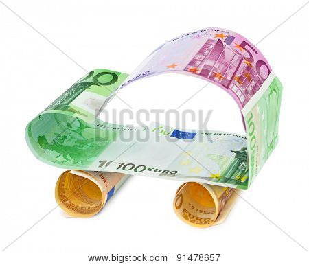 Car made of money isolated on white background