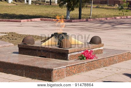 The eternal flame at the monument to fallen soldiers