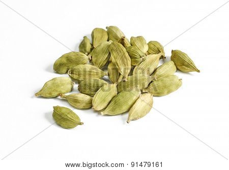 Close up of cardamon pods on white background. Selective focus