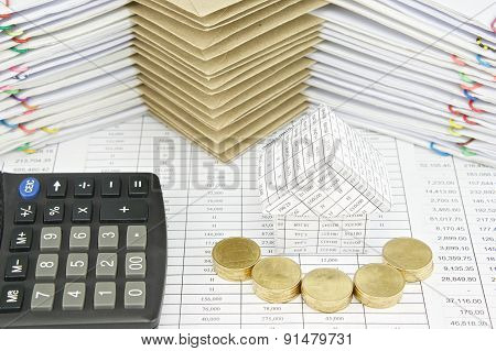 Pile Of Gold Coins In Front Of House