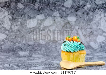 One Cupcake On Gray Background