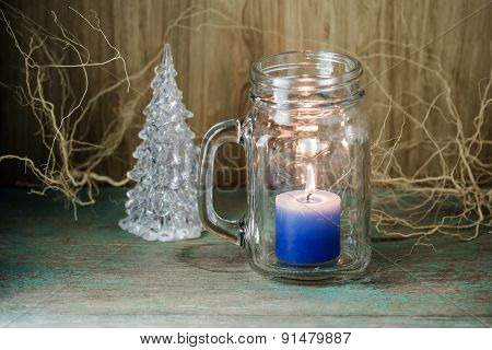 Blue Candle In Bottle Glass