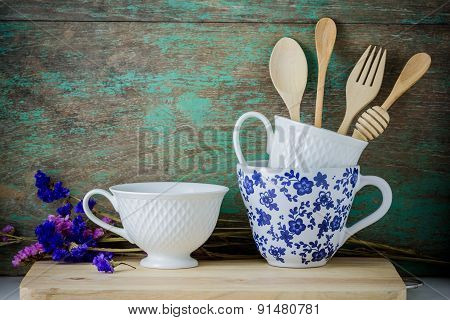 Wooden Kitchen Utensils And Coffee Cups