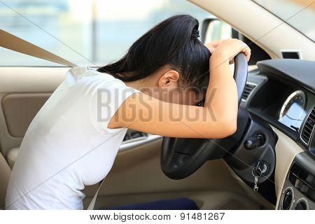 sad woman driver in car