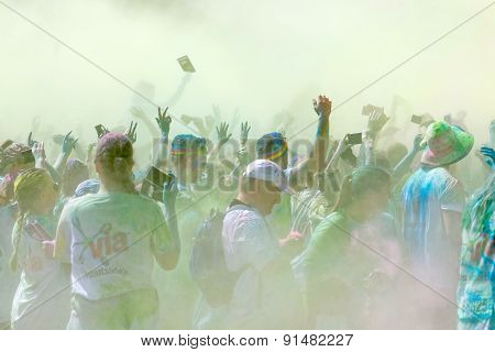 The Participator In The Color Run Waiving The Arms In The Sky