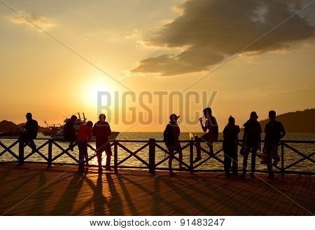 Local People And Tourist Enjoying Sunset