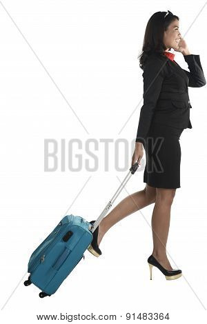 Asian Business Woman With Cellphone And Suitcase