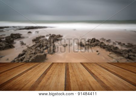 Long Exposure Landscape Beach Scene With Moody Sky With Wooden Planks Floor