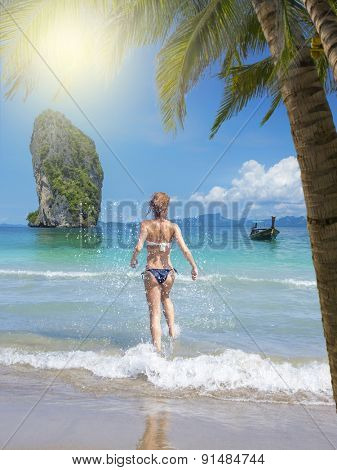 Beautiful woman having fun on the beach. Poda island. Thailand