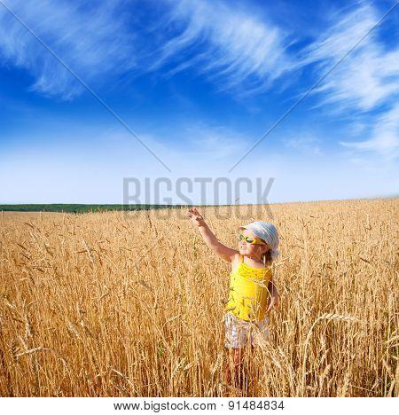 Little girl on wheat field