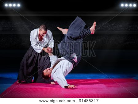 Two martial arts fighters at sports hall