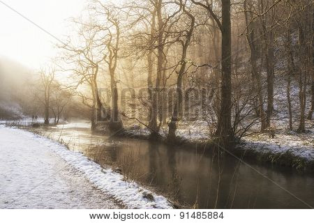 Beautiful Winter Snow Covered Countryside Landscape Of River Flowing