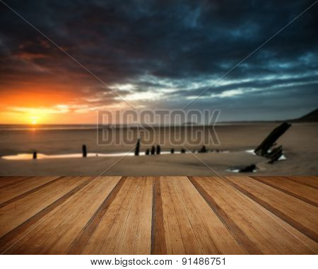 Beautiful Dramatic Sunset Landscape Over Shipwreck On Rhosilli Bay Beach With Wooden Planks Floor