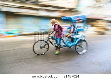 Rickshaw Rider Transports Passenger Early Morning