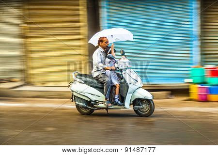 Grandfather Brings His Granddaughter To School By Motobike