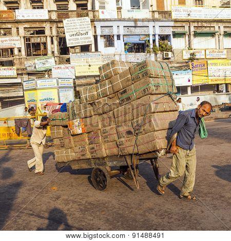 Rickshaw Rider Transports Cargo