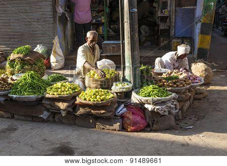 Man Selling Vegetables At Chawri Bazar In Delhi, India