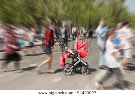 Abstract Background. Pedestrians And  Mother With  Pram Crossing A Street (motion Blurred Image)