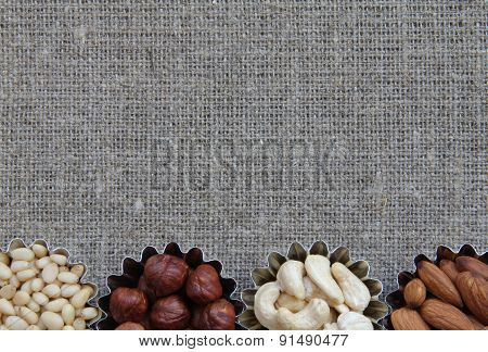 Various Kinds Of Nuts On Fabric Texture