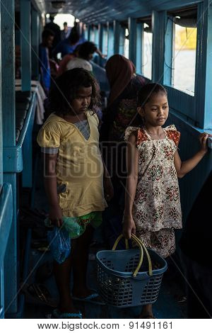 Little Girls Selling Snacks On Ferry Boat