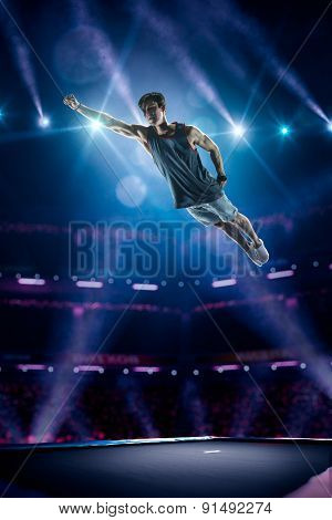 Young man is jumping on trampoline
