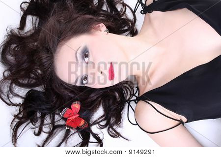 Brunette With Red Lips Lying