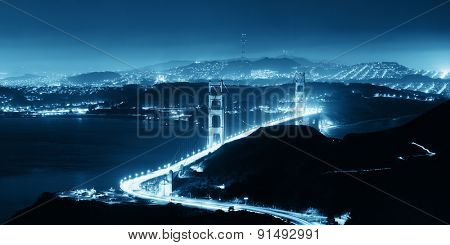 Golden Gate Bridge in San Francisco at night panorama viewed from mountain top