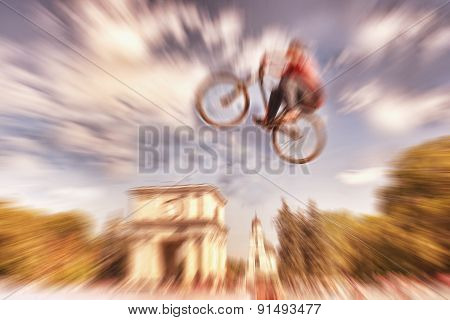 Abstract Background . Boy On A  Mountain Bike Jumping. Motion Blur Photo. Competition In Kishinev