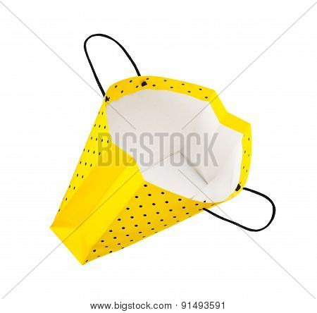 shopping bag falling through the air on an isolated white background