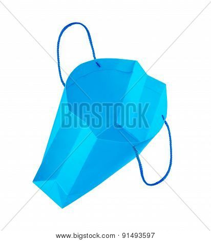 Empty Light Blue Gift Bag Falls Through The Air On An Isolated White Background