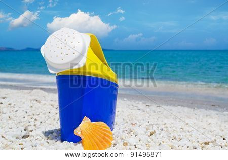 Plastic Watering Can By The Sea